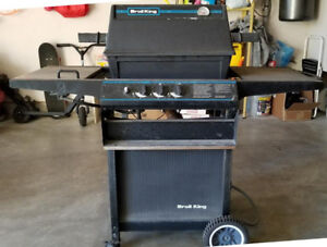 Natural Gas BBQ with side burner and cover.