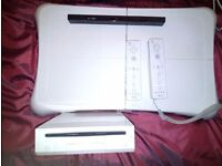 Wii package. Wii console, Wii fit balance board, 2 wireless controls, 2 Nunchuks, sensor bar, games