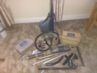 Vintage Kirby vacuum cleaner - working but split hoses and bag. Lots of accessories included