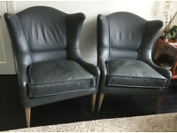 2 grey leather armchairs