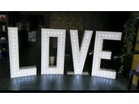 Giant 4 ft. LOVE Light up led letters to hire for weddings