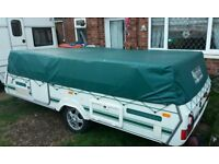 pennine pathfinder folding camper with large awning and toilet.