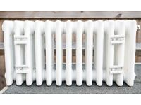 White Acova Classic steel column radiators with timeless 4-column design