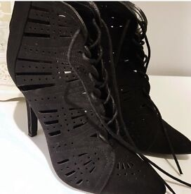 Black laser cut pointed boots