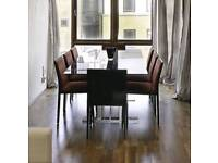 6/8 seat gloss black dining table with gloss black chairs
