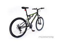 Muddy fox black and green mountain bike
