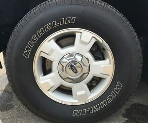 Aluminum tire rims from ford f150. 2 avail.