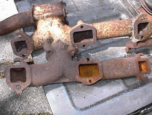 2 USED 1957-58 OLDS EXHAUST MANIFOLDS RH + LH 75 EA $130PR