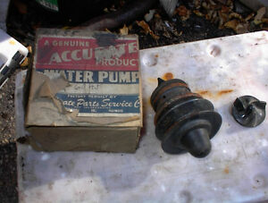 NEW FORD V8 60HP WATER PUMP AND BAKELITE IMPELLER IN BOX