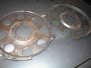 2 NICE USED CLEAN STRAIT 1957-58 OLDS FLEX PLATES $35.00 EACH