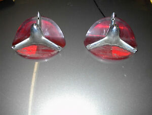 USED PR OLDS GUIDE #R3-57 TAIL LITE LENSES WITH ROCKETS S88,98