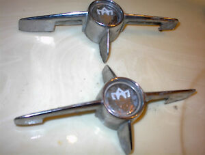 2 USED 1958 OLDS TRUNK STARS/HANDLE NO CRAKS $10EA /$15PR