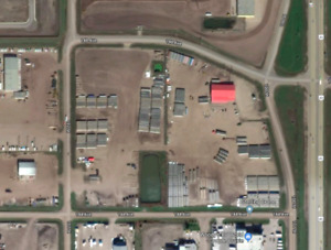 Industrial Yard & Shop. 24 acres. 12000 SF. Highway Frontage.
