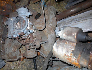 USED 1955,6 OLDS 324 V8 2BBL INTAKE MANFLD AND CARB $100