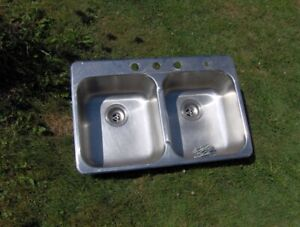 Stainless steel, double bowl sink (Kindred) with 8 sink hangers.