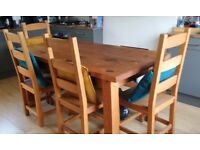 Solid wood reclaimed pine six seater dining table with four chairs and bench