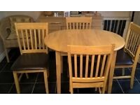 Compact Extending Oak Dining Table and 4 Chairs