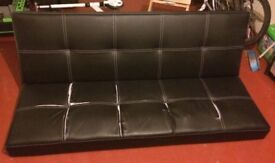 Faux leather book/flip type Sofabed, in black colour. Damaged seat upholstery