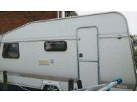 4 berth touring caravan with full awning.