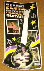 ELVIS-PRESLEY-TOY-GUITAR-STILL-SEALED-ON-ORIGINAL-BACKING-CARD