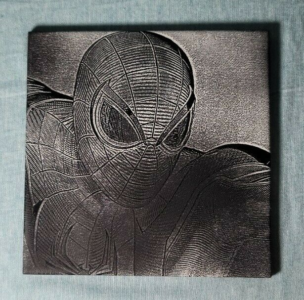 """Ceramic tile with black and white image of spiderman. 6x6."""" Permanent."""