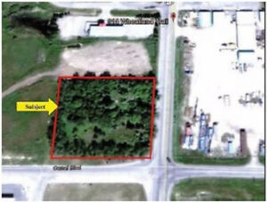 HOTEL ZONED, Strathmore, Corner Lot at Wheatland Trail and Canal