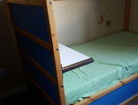 ikea loft bed with canopy and a shelf and lamp
