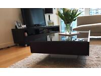 Modern dark brown wood and glass coffee table and matching TV unit
