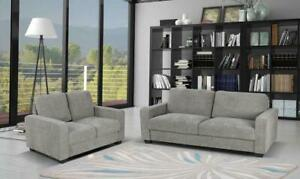 new in box--sofa and love seat set