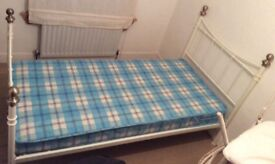 Single white bed frame and mattress
