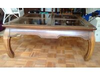Lovely mahogany coffee table with bevelled glass