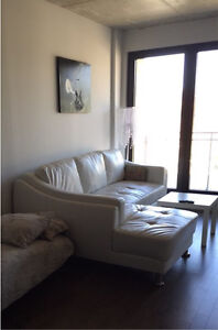 White faux-leather couch medium size + FREE white IKEA table