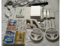 Nintendo Wii package including 16 games, 4 controllers and balance board