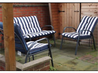 Outdoor set of stylish chairs with waterproof cushions