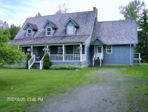 Home & Acreage for horses and family.