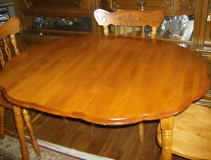 Maple dining table with four chairs