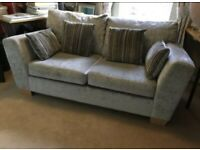 Grey two seater sofa