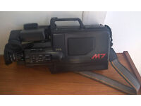 PANASONIC M7 VHS movie camera with attachments and case