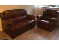 Leather two seater sofa and electric reclining armchair for sale