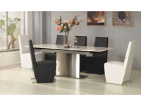 Brand New Dinning Table Set...Table is extendable and includes 6 chairs