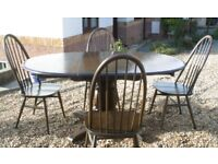 ERCOL DINING TABLE AND 4 CHAIRS SEE PHOTOGRAPHS