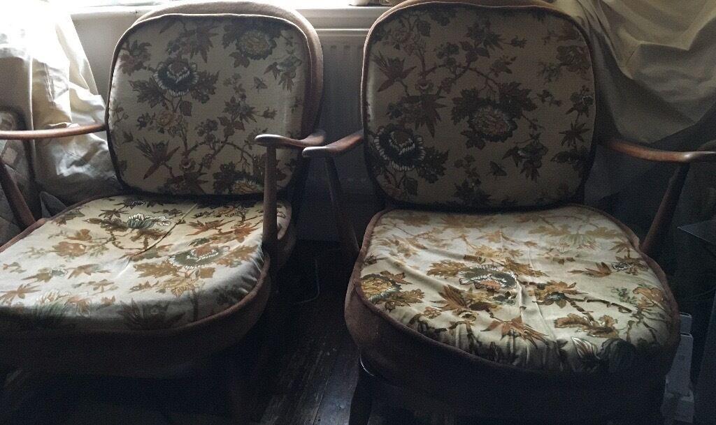 Pair of vintage Ercol fleur de lis chairs in excellent condition