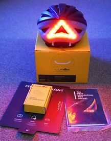 Lumos Cycle Helmet (combines front and rear lights with indicators and automatic brake lights.)