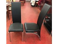 two single high back chairs