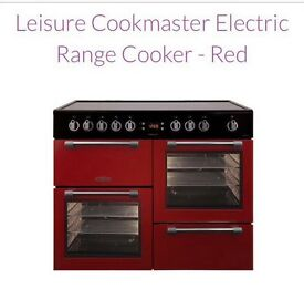Red double oven and red glass front fridge freezer