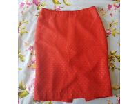 Next orange and white polka pencil skirt.