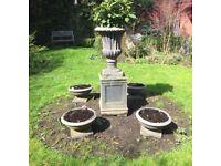 Beautiful ornamental garden urn with plinth