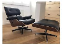 Black leather lounge chair and ottoman Eames chair