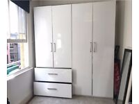 Lovely gloss white wardrobe, free to a good home! lots of storage space inside