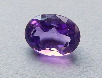 Genuine Amethyst Oval Faceted Stone 9x7 mm  Med. Shades of Purple ()